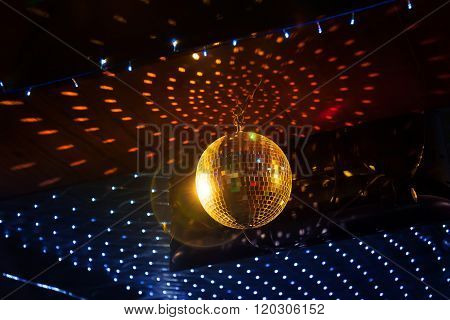Mirror Disco Ball With Light Reflection On The Ceiling