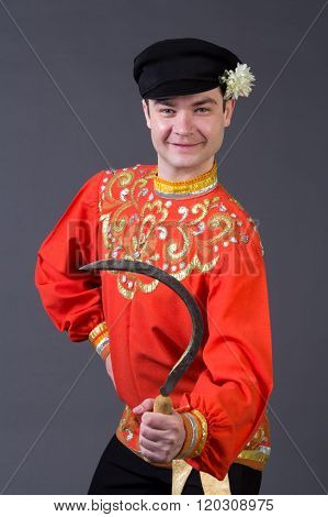 Attractive Russian Guy With Sickle In Folk Costume