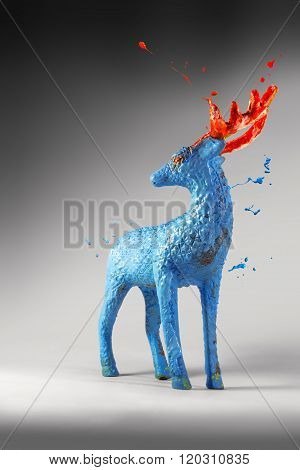 Bursting Blue Paint On A Deer Sculpture