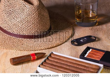 Siesta - Cigars, Straw Hat And Scotch Whiskey On A Wooden Desk
