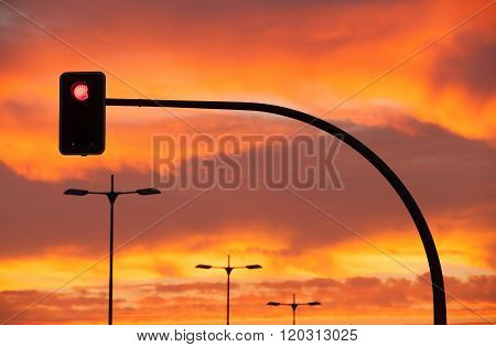 Red Traffic Light In A Dramatic Sunset