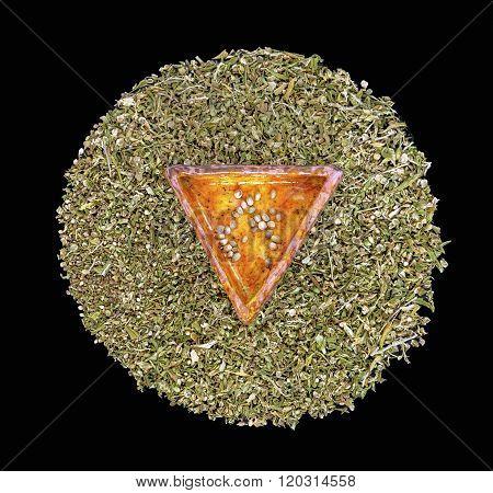 Hemp Seeds In A Triangular Ceramic Piece