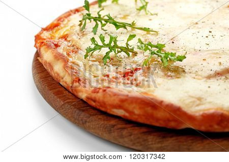 Pizza full of cheese on wooden board isolated on white background, close up