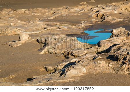 Rocky Beach Of Atlantic Ocean With Puddle
