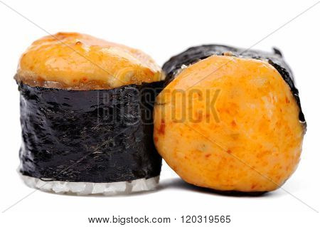 Pair Of Tasty Baked Japanese Rolls With Spicy Cheese And Nori Isolated