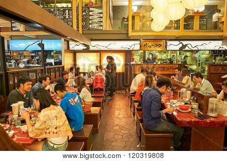 BANGKOK, THAILAND - JUNE 20, 2015: food court interior. There are a lot of cafes and restaurants in shopping malls and department stores of Bangkok