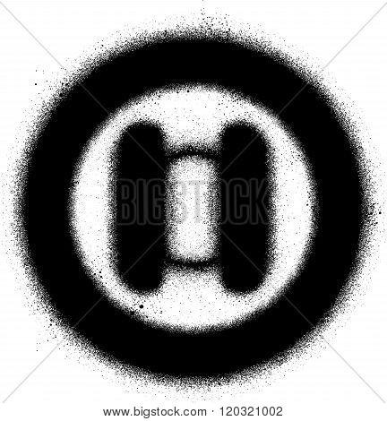 circular sprayed graffiti sign in black over white
