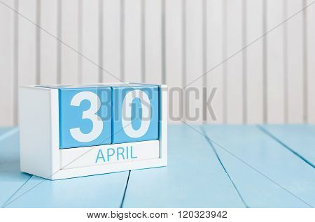 April 30th. Image of april 30 wooden color calendar on white background.  End month. Spring day, emp