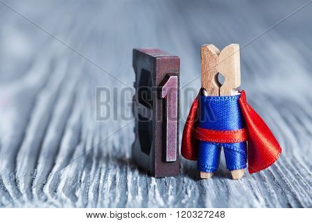 Leader superhero concept. Clothespin super hero and 1 one written with colored vintage letterpress.