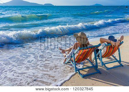 Couple on a deckchair at the tropical beach