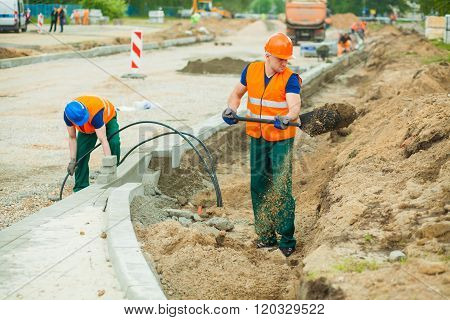 Workman Using Spade