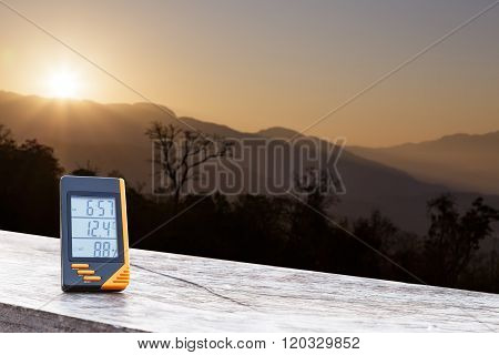 Digital Display Thermometer With Mountain And Sunlight