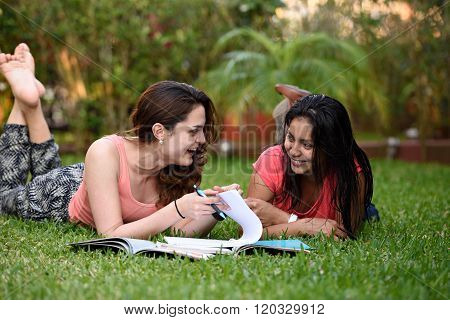 Happy Girl Learning In Grass