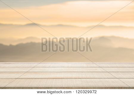Wood Table Top On Blurred Mountain Landscape
