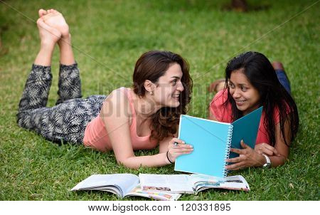 Students Lay On Grass