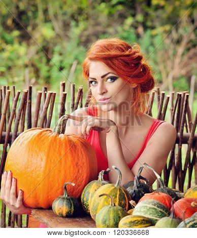 Beautiful Young Woman With Pumpkin. Autumn. Harvest Season.