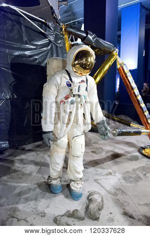 LONDON - FEBRUARY 08: Exhibit of NASA astronaut walking on the moon in front of large reproduction of the lunar lander