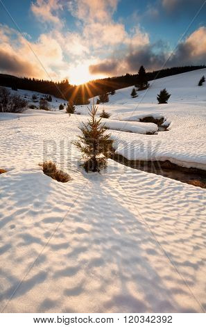 Sun Down Over Mountain River In Winter