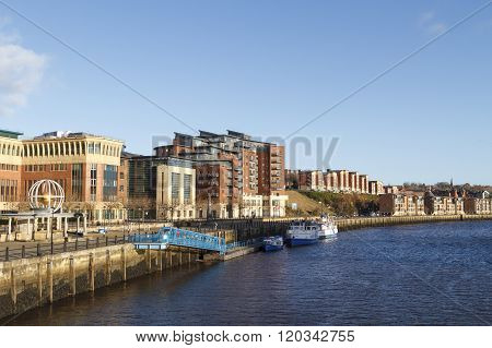 NEWCASTLE ENGLAND - DECEMBER 7 2014: Quayside and Hadrian's wall path with the new riverside developments on the banks of the river Tyne.