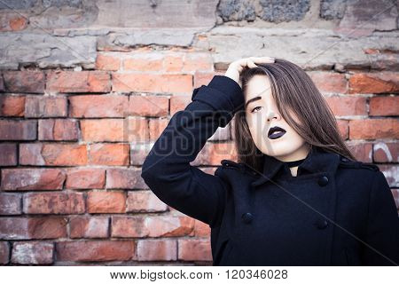 Portrait Of A Teenage Girl With Black Lipstick