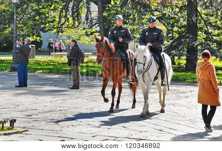 MADRID, SPAIN - OCTOBER 27, 2015 :Police on horse patrol in the park along the  National Museum of the Prado, one of the largest art museums in Europe