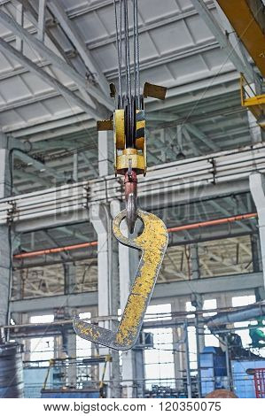 Close Up Of A Yellow Factory Crane Hook