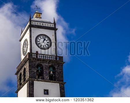 Clock tower of Church of San Sebastian at Ponta Delgada in Ponta Delgada, Sao Miguel Island, Azores, Portugal ** Note: Visible grain at 100%, best at smaller sizes