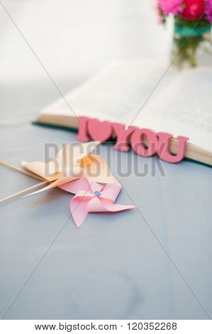 Wooden Letters, I Love You, Pinwheel And Book.