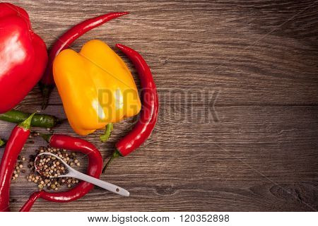 On Top View Of Chili, Sweet Pepper And Spicy Pepper