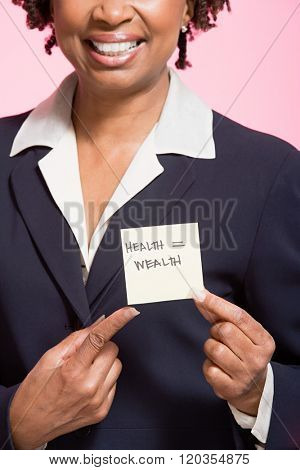 Woman holding an adhesive note