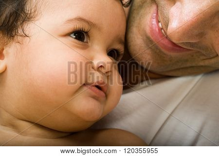 Baby girl and father