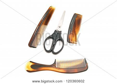 Different Combs And Scissors