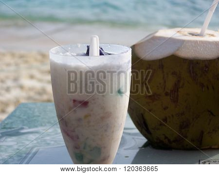 Natural coconut drinks close up, refreshing outside ** Note: Visible grain at 100%, best at smaller sizes