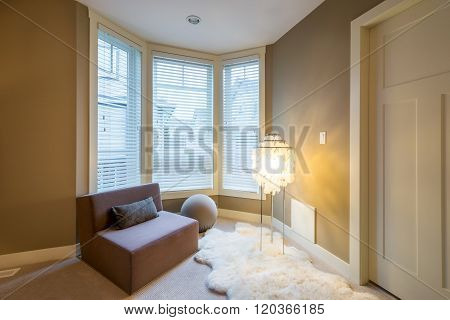 Fragment of a modern luxury master bedroom with a large chair lamp and a sheepskin rug. Interior des