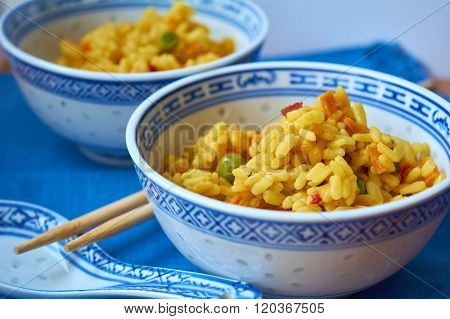 Appetizing risotto on blue background. Mix seafood with risotto.
