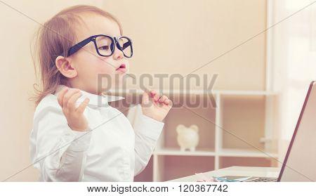Smart Toddler Girl Wearing Big Glasses Using Her Laptop