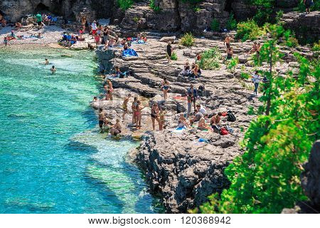 People relaxing at beautiful inviting Bruce peninsula rocky beach