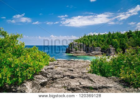 Amazing natural rocky beach landscape view and tranquil azure clear water beautiful Bruce peninsula