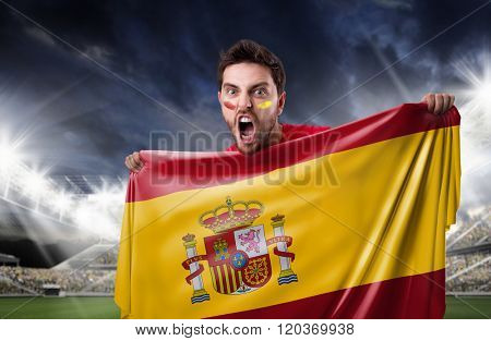 Fan holding the flag of Spain in the stadium