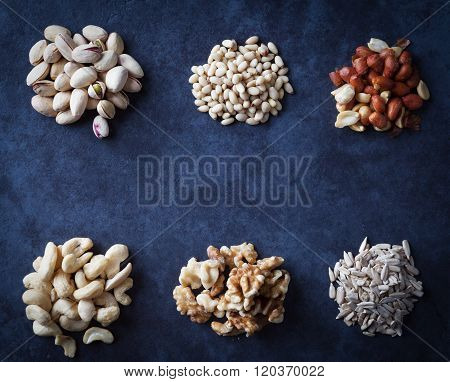Nuts On Grunge Background Flat Lay.