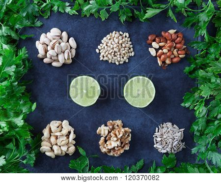 Nuts And Lime On Grunge Background Flat Lay.
