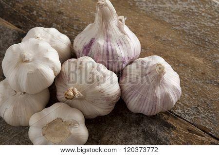 Pile Of Seven Whole Garlic Bulbs