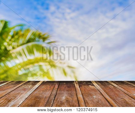 Wood Table And Blur Coconut Tree