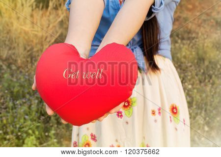 Women Hand Gently Hold Red Heart With Text Get Well