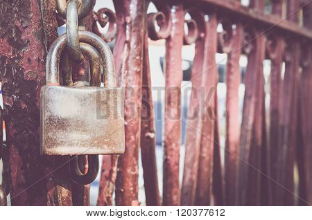 Old rusted lock on the red rusted door
