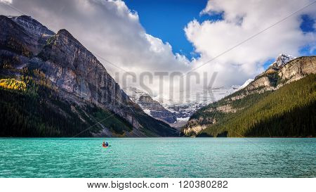 Canoers on Lake Louise with Mount Victoria in the Background