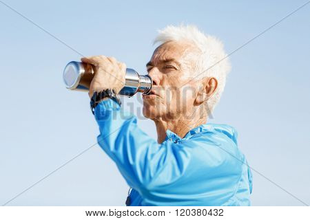Man drinking from a sports bottle