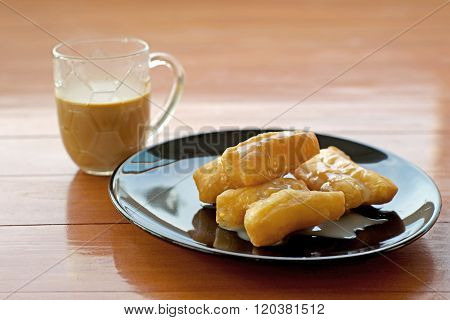 Deep Fried Doughstick With Sweetened Condensed Milk And Coffee