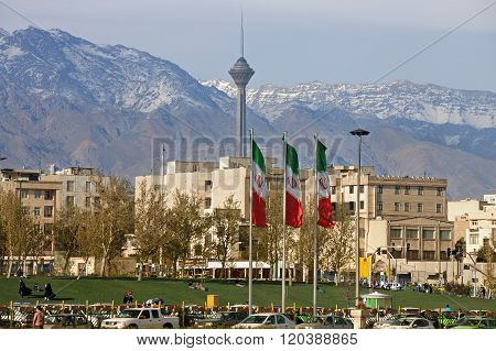 City Of Tehran With Milad Tower And Iran Flags In The Frame
