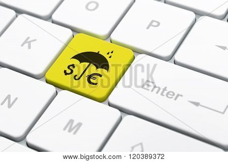Security concept: Money And Umbrella on computer keyboard background